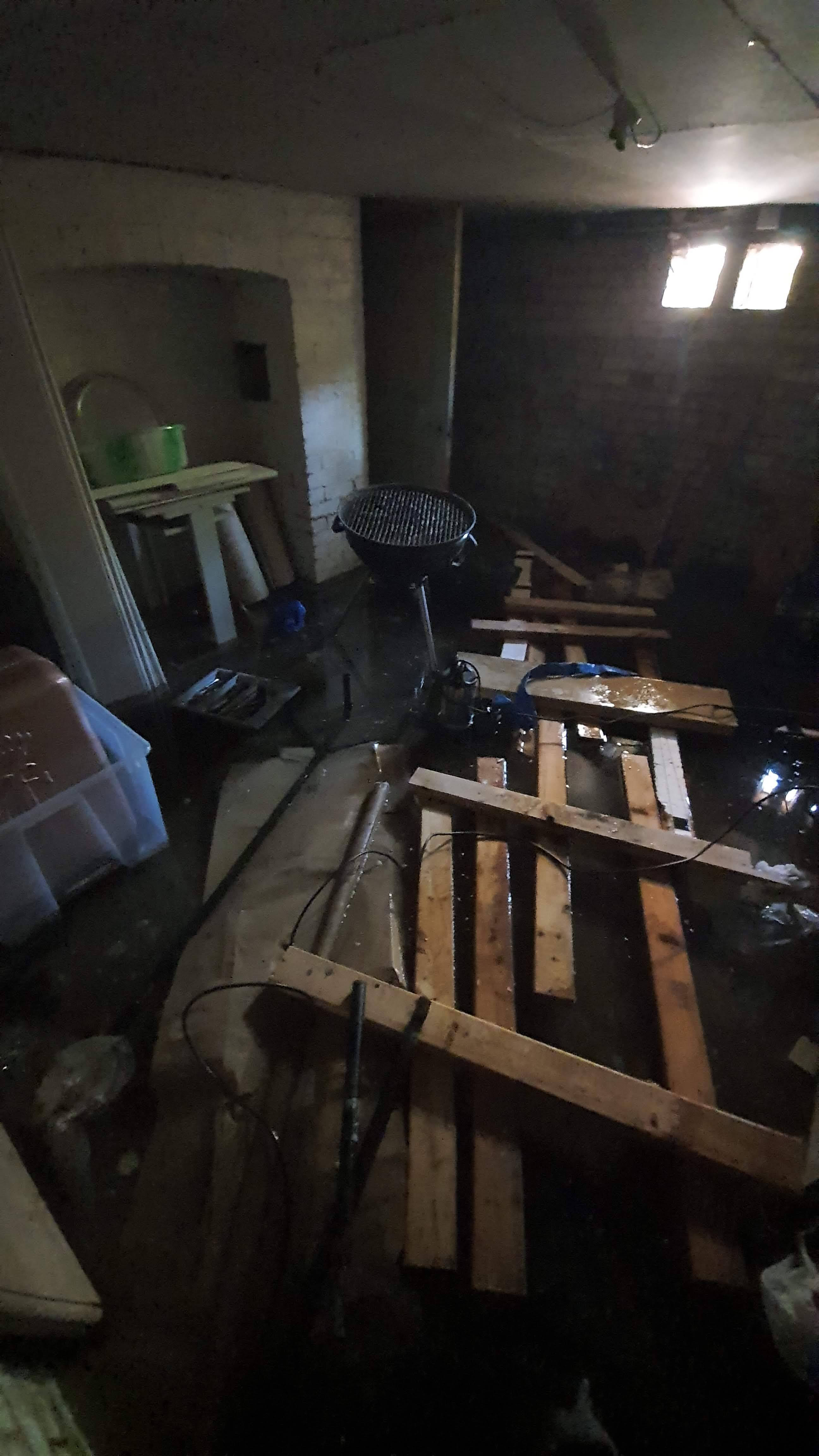 Flooded basement containing water damaged property