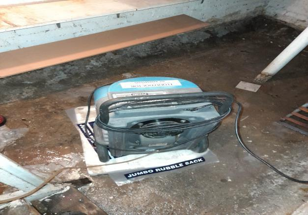 dehumidifier being used in flooded basement